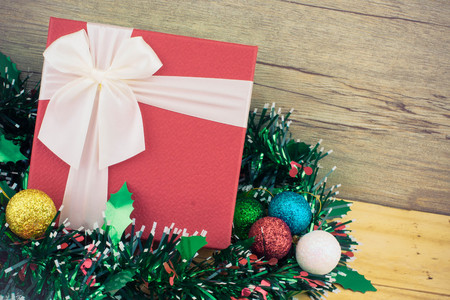 pine needles close up: Christmas background with a ornaments, red gift box