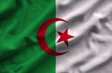 Flag of Algeria. Flag has a detailed realistic fabric texture. Stock Photo
