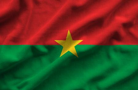 Flag of Burkina Faso. Flag has a detailed realistic fabric texture. Stock Photo