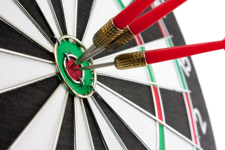 Red arrow is center of target dartboard on white background.,Concept of  success 写真素材