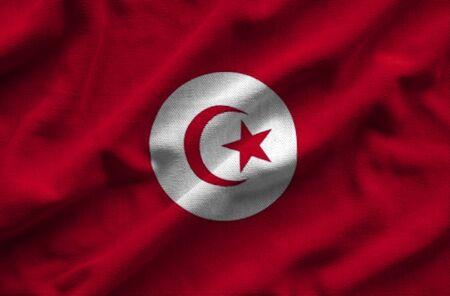 Flag of Tunisia. Flag has a detailed realistic fabric texture. Stock Photo