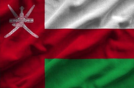 Flag of Oman. Flag has a detailed realistic fabric texture. Stock Photo