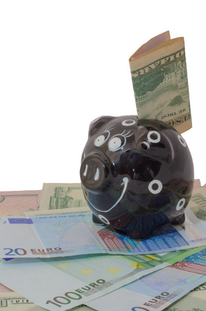 moneyed: piggy bank standing on money dollars and euros