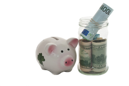Money jar and a piggy bank    photo