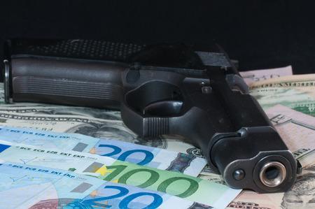 payee: money as a backdrop and a gun