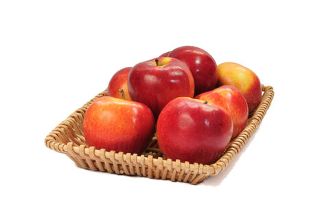 Red apples on a basket tray  photo