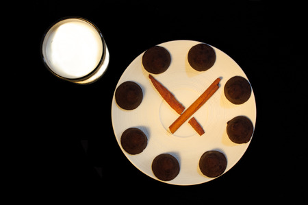 Glass of milk and a chocolate truffle fantasy clock  photo