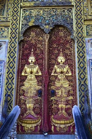 Guardian deity image on the door of the temple In Chiangmai , Thailand. Wat Ketkara,.