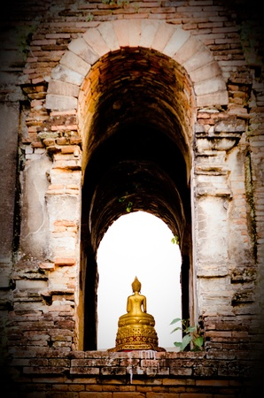 The Golden Buddha Monk Statue at the temple in ChiangMai, Thailand. Show at WatJedYod ChiangMai Province, TH. Thais Image Buddha around 700 years ago. and say prayers to Buddha for Golden Buddha Image.