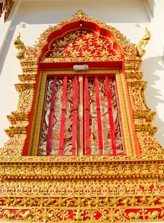 eligion: Thai Lanna style temple door in Wat Jedyod at Chiangmai, Thailand. Stock Photo