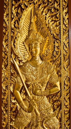 Thai Lanna style temple door in Wat Jedyod at Chaingmai , Thailand. photo