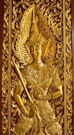 eligion: Thai Lanna style temple door in Wat Jedyod at Chaingmai , Thailand.