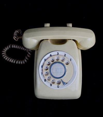Vintage telephone isolated on back background