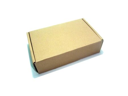 Closed brown paper box on white background
