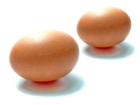 Two brown eggs on white background  And two brown and back shadow