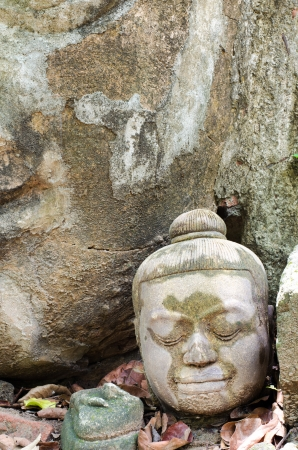 Ancient Head Buddha statue in Wat Umong at Chiangmai province, Thailand. (Made between 1400-1550 AD.)