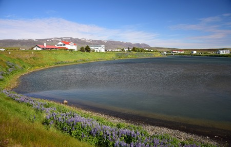 Blönduos, a small town in Iceland, with the ocean in the front and mountains in the background. Stock Photo