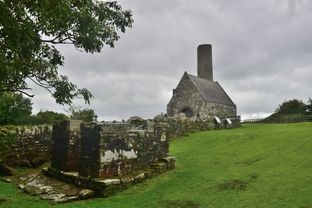 The ruins of an ancient church and a round tower on Holy Island in Lough Derg in Ireland, County Clare.