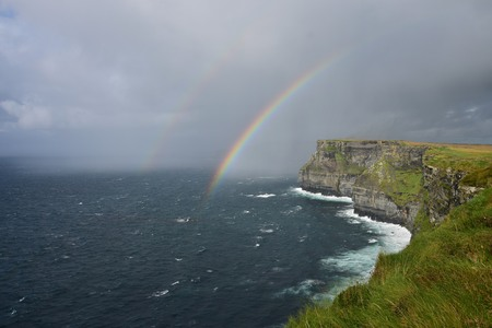 A double rainbow over the Cliffs of Moher on the west coast of Ireland in County Clare. Stock Photo