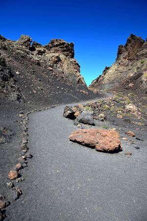 A path in the volcano El Cuervo in Lanzarote, one of the few volcanos where it is allowed to go in.