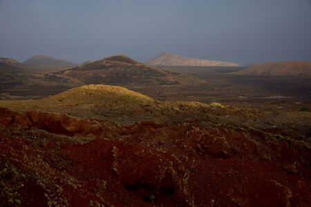 Beautiful volcanic landscape early in the morning in Lanzarote, Spain. The calima wind makes a surreal light.