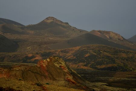 Beautiful volcanic landscape early in the morning in Lanzarote, Canary Islands, Spain. The calima wind makes a surreal light. 스톡 콘텐츠
