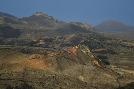 Beautiful volcanic landscape in the morning in Lanzarote, Canary Islands, Spain. The calima wind makes a surreal light.