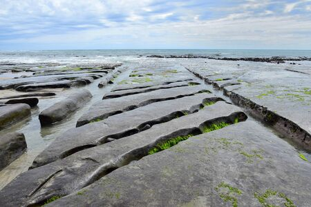 The rocks and cliffs at the northwest coast of the South Island of New Zealand are washed out by the waves.