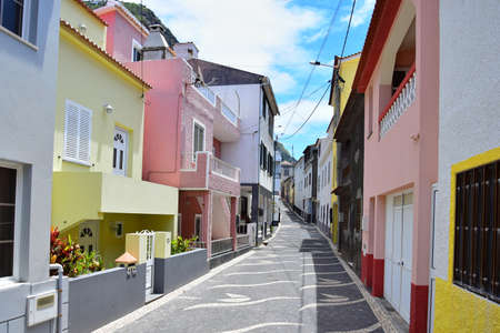 Paul do Mar, a beautiful small town at Madeira, Portugal. A small road with colorful houses.