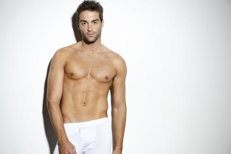 mid adult man: Retrato de hombre de mediana edad sin camisa, estudio