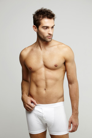 only mid adult men: Mid adult man in underpants, studio shot Stock Photo