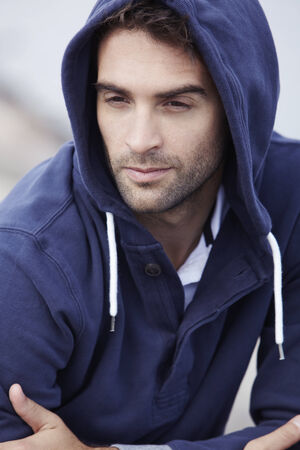 hooded top: Mid adult man wearing hooded top outdoors