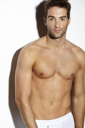 Portrait of shirtless mid adult man, studio photo