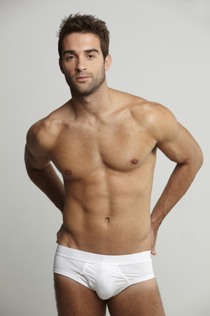 Portrait of mid adult man in underpants, studio shot