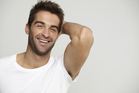 man hair: Mid adult man in t-shirt, laughing Stock Photo