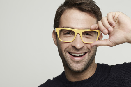 Portrait of mid adult man in yellow glasses Banque d'images