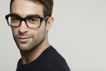 Closeup portrait of mid adult man in glasses