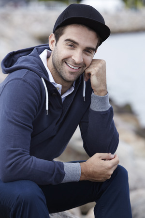 hooded top: Portrait of mid adult man in cap and hooded top Stock Photo