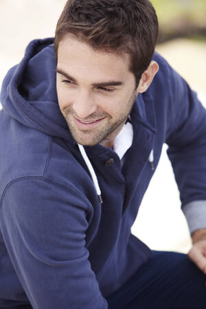 hooded top: Mid adult man in hooded top outdoors, smiling