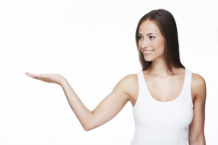 Young woman with arm out against white background