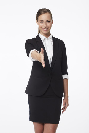 people shaking hands: Portrait of young businesswoman shaking hands