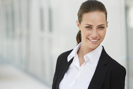 Portrait of young businesswoman, smiling photo