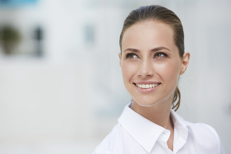 Young businesswoman looking away and smiling