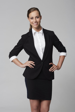 Portrait of young businesswoman in studio, smiling