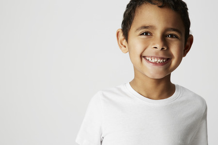 cheeky: Boy with cheeky smile in studio