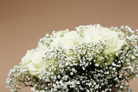 Wedding bouquet against studio background photo