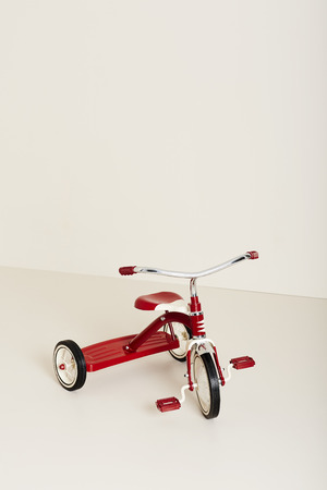 Retro-styled tricycle in studio Stock Photo
