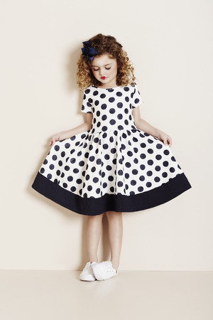 Young girl in spotty dress