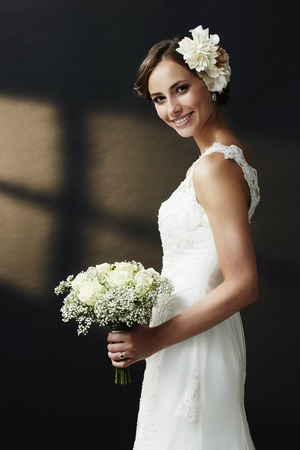 wedding flower: Stunning young bride holding bouquet, portrait Stock Photo