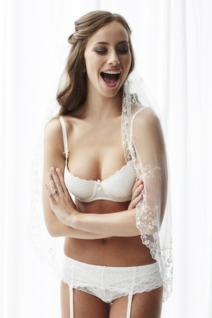 sexy bride: Sexy young bride in lingerie, smiling